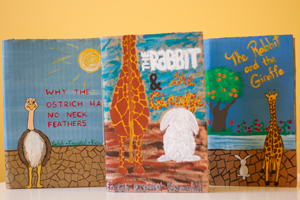 Image of cardboard books crafted by Rebecca Mandich (BA'13)