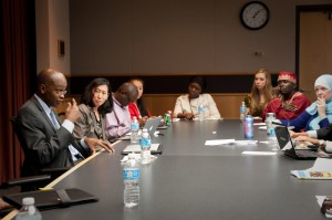 Image of John Mugane leading a workshop for faculty and students.