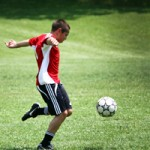 Image of student kicking a soccer ball